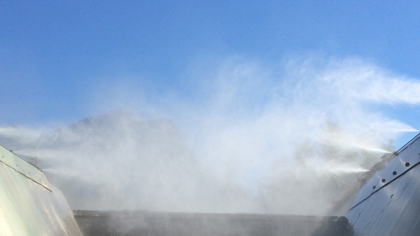 Dust abatement techniques with water mist cannons
